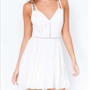 White elegant, open back dress.